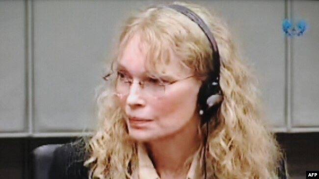 Mia Farrow testifies before a war crimes trial in The Hague in 2010.