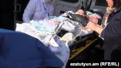 Armenia - Six-month-old Seryozha Avetisian, the only survivor of the deadly attack on a Gyumri family, is transferred to a hospital in Yerevan, 13Jan2015