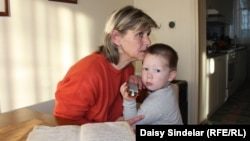 """You forget how it was, and you take things for granted,"" says Alma Alic, pictured with her 3-year-old grandson."