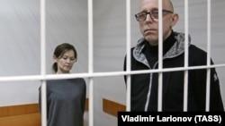 Yelena Reshetova (left) and Vadim Vinogradov attend the court hearing on March 18.