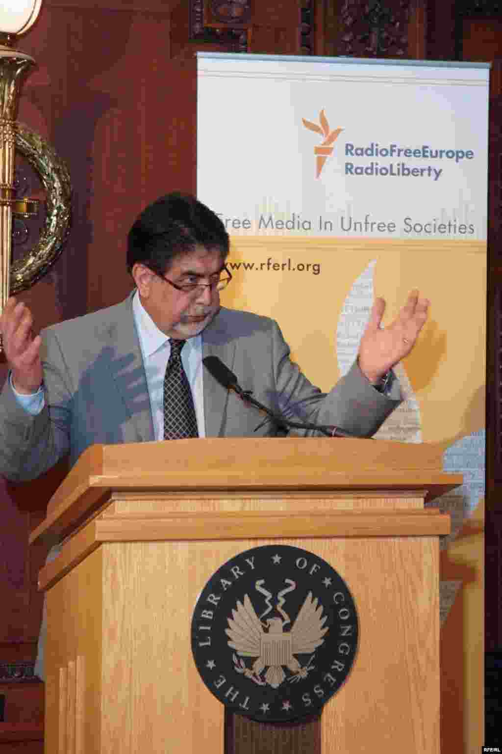 RFE/RL Associate Director of Broadcasting Akbar Ayazi speaks at the reception marking the opening of the exhibit - (Photo by P. Alunans)