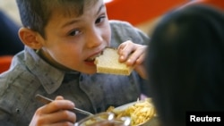 A child has a meal at an orphanage in the southern Russian city of Rostov-na-Donu.
