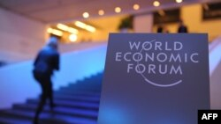 Swiss. Participants arrive at the congress centrre prior to the opening of the World Economic Forum in Davos. Junuary 21, 2014.