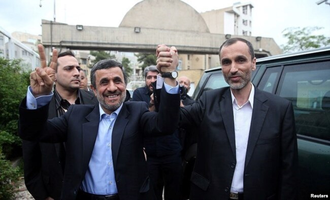 Ahmadinejad with his former vice president, Hamid Baghaei, after registering as a presidential candidate on April 12.