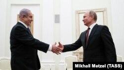 Премиерът на Израел Бенямин Нетаняху и Владимир Путин по време на срещата им в Москва.
