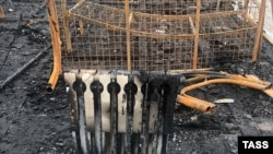 На месте пожара в палаточном детском лагере «Холдоми», 23 июля 2019