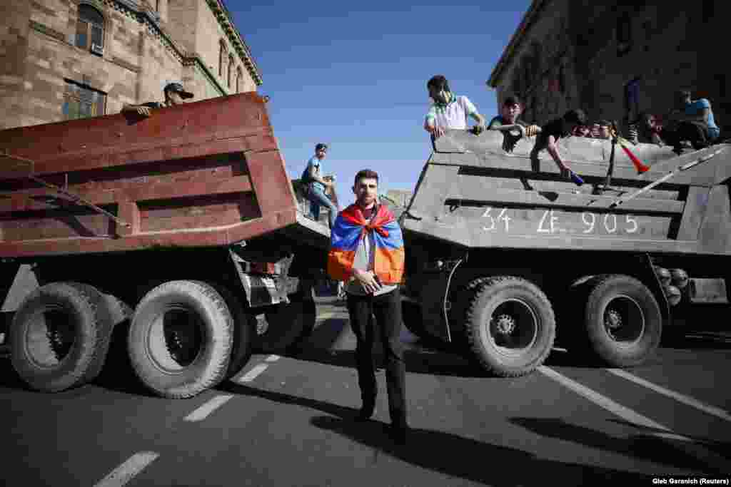 Armenian protesters block a road after opposition leader Nikol Pashinian announced a nationwide campaign of civil disobedience in Yerevan on May 2. (Reuters/Gleb Garanich)