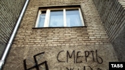 An anti-Semitic slogan and a Nazi swastika drawn on a house in Vladivostok, Russia.