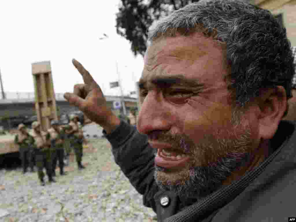 A protester cries as soldiers move in trying to convince demonstrators to dismantle their barricades in Tahrir Square.