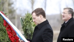 Russian President Dmitry Medvedev and his Polish counterpart, Bronislaw Komorowski, attend a commemoration ceremony in 2011 at the site of the 2010 plane crash near Smolensk.
