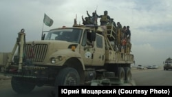 Vehicul militar șiit în apropiere de Mosul, nordul Irakului