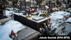 The grave of a murdered Slovak journalist Jan Kuciak at a cemetery in Stiavnik on February 20.