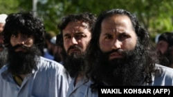 Taliban prisoners stand during their release from the Bagram prison some 50 km north of Kabul on May 26.