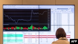 A woman looks at a screen at the Moscow Interbank Currency Exchange (MICEX) on March 4, 2014.