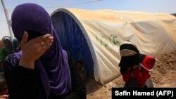 В лагере к югу от иракского города Мосул.