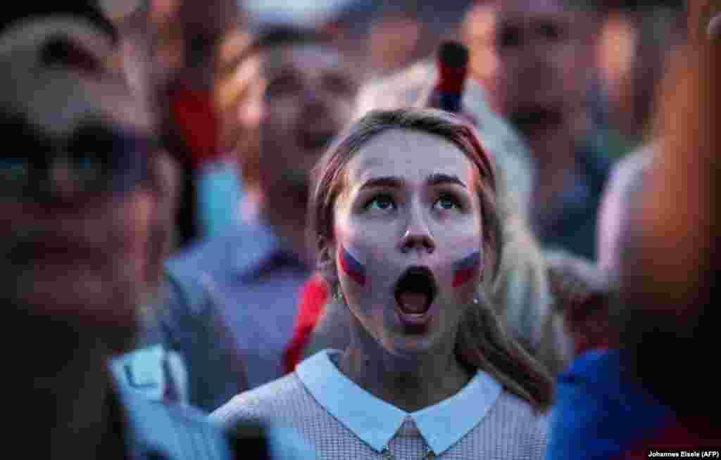 Расейская заўзятарка на матчы Расея - Эгіпэт у Ніжнім Ноўгарадзе. (AFP/ Johannes Eisele)