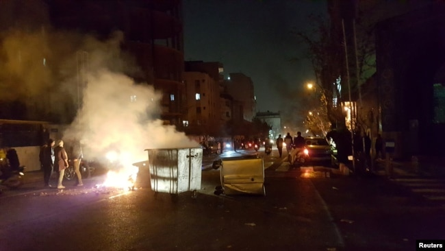 A photo obtained by Reuters from social media showing people protesting on the streets of Tehran on December 30.