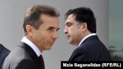 «Грузия арманы» коалициясының жетекшісі, премьер-министр Бидзина Иванишвили мен «Біртұтас ұлттық қозғалыс» партиясының лидері, Грузия президенті Михаил Саакашвили. Тбилиси, 9 қазан 2012 жыл.