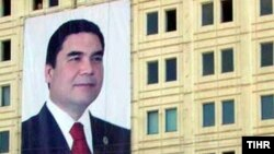 A portrait of Turkmen President Gurbanguly Berdymukhammedov hangs from the side of a building in the capital, Ashgabat, ahead of parliamentary elections.