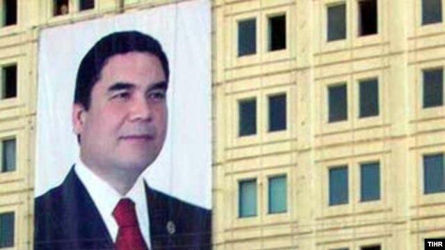 A huge portrait of Turkmen President Gurbanguly Berdymukhammedov on the side of a building in Dashoguz