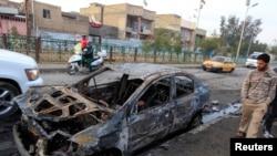 صورة لآثار تفجير سيارة مفخخة في بغداد يوم 14 كانون الثاني 2014