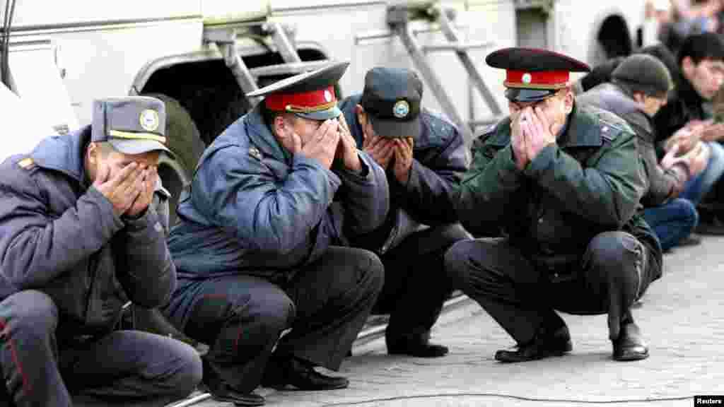 Kyrgyz police officers take part in prayers on the first day of the Muslim holiday of Kurban Bairam (Eid al-Adha) in Bishkek on October 26. (Reuters/Vladimir Pirogov)