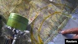 Mütəxəssislər qəzalı Fukushima stansiyasından radiasiya yayılması xəritəsi üzərində işləyirlər, 4 aprel 2011