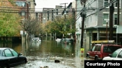"""Нью-Йорк после урагана """"Сэнди"""". По мнению авторов Global Risks-2013, измененения климата все сильнее угрожают миру."""
