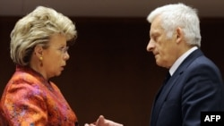 EU Justice Minister Viviane Reding (left) speaks with European Parliament President Jerzy Buzek