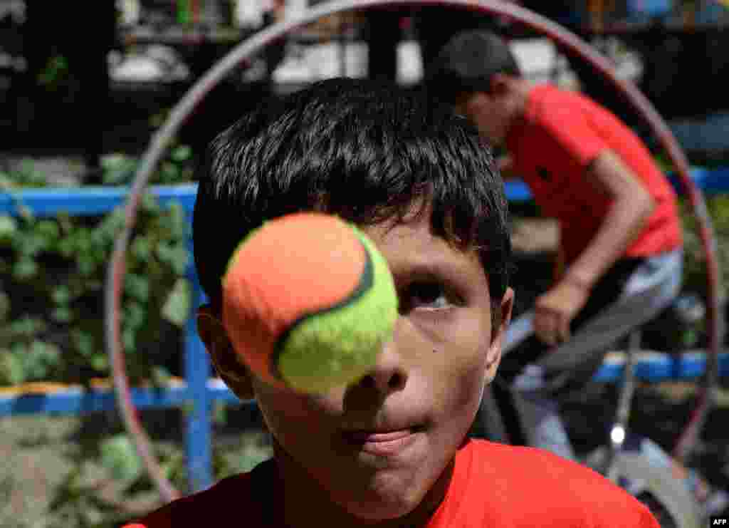 A young juggler performs during the eighth Afghanistan Juggling Championships in Kabul. (AFP/Shah Marai)