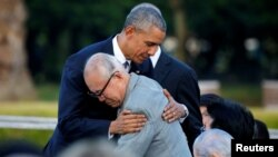 U.S. President Barack Obama (left) hugs atomic bomb survivor Shigeaki Mori as he visits the Hiroshima Peace Memorial Park in Japan on May 27.
