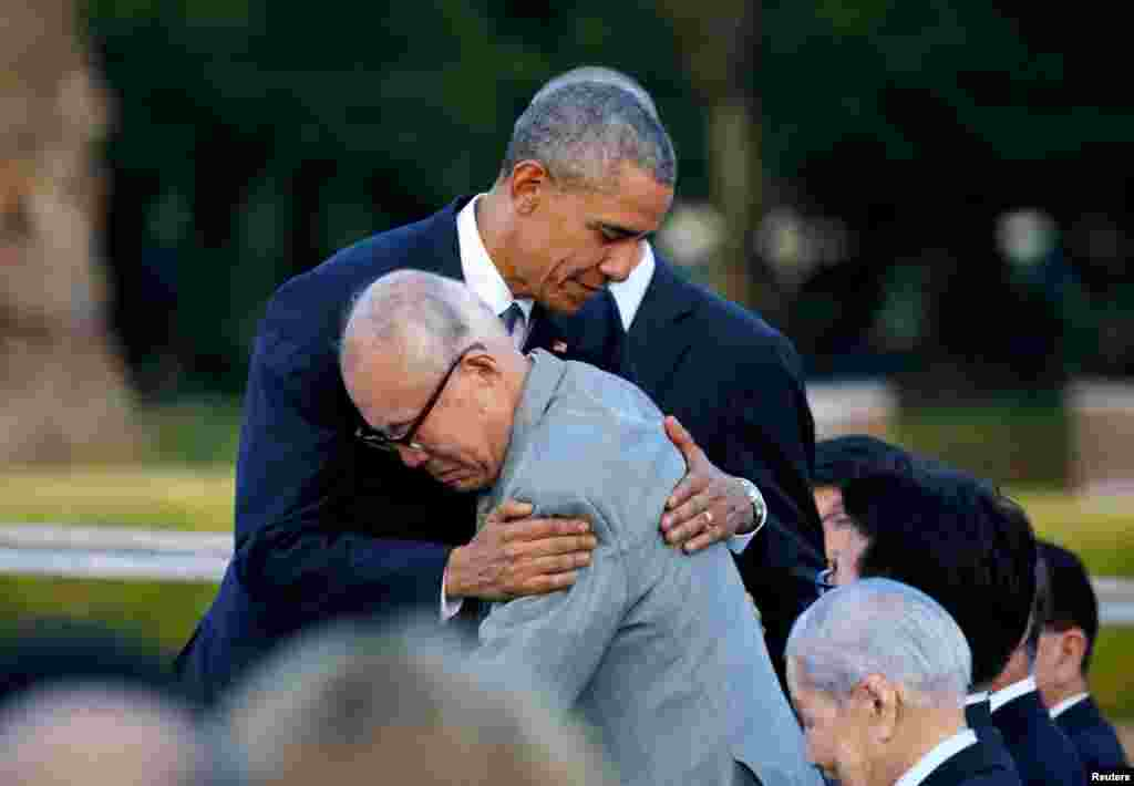 U.S. President Barack Obama hugs Shigeaki Mori, a survivor of the atomic bombing of Hiroshima, as he visits the Hiroshima Peace Memorial Park in Hiroshima, Japan, the first sitting U.S. president to do so. (Reuters/Carlos Barria)