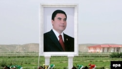 A huge portrait of President Gurbanguly Berdymukhammedov beside the horse track in Ashgabat