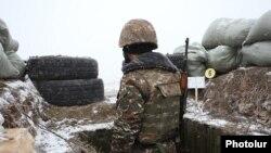 Armenia - An Armenian soldier on combat duty on the border with Azerbaijan, 30Dec2015.