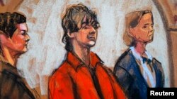 Defense attorneys Miriam Conrad (left) and Judy Clarke flank Dzhokhar Tsarnaev in court in Boston in this July 10, 2013, court sketch.
