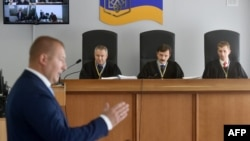 A panel of three judges listens to Yanukovych's lawers in Kyiv on June 26.