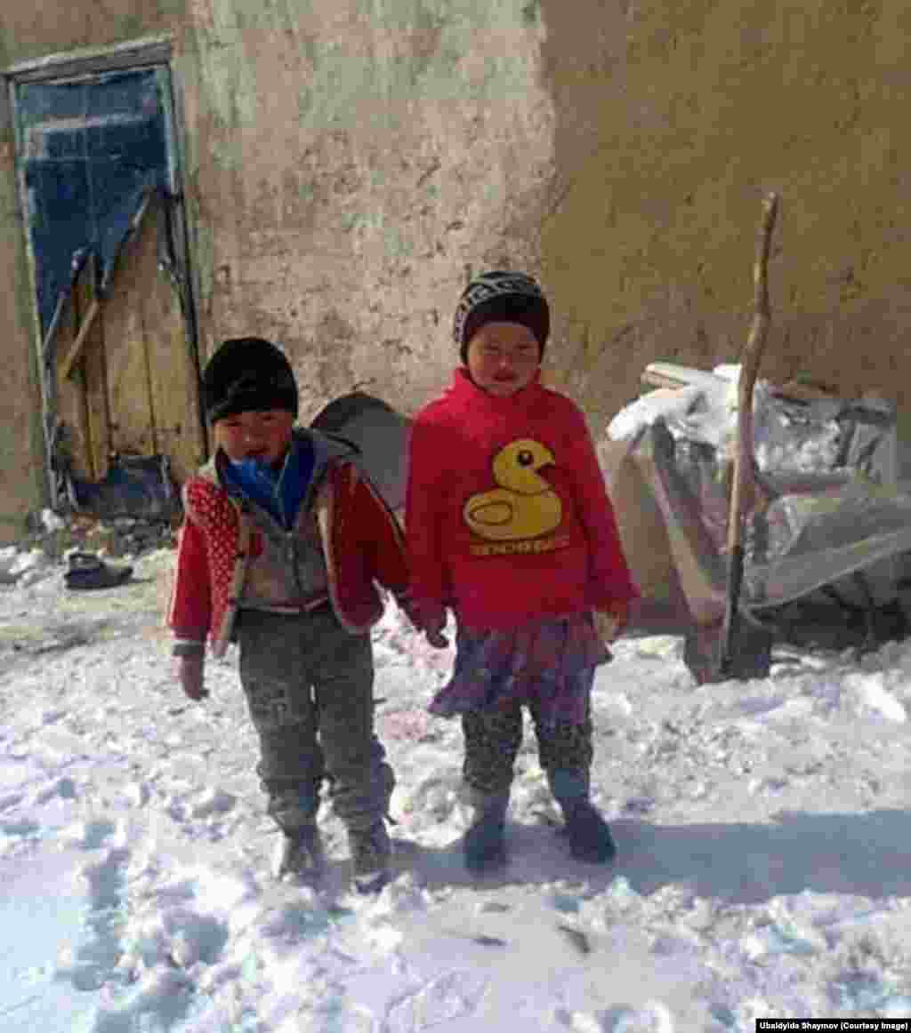 The photographer's young niece and nephew. Their father, Shaimov's brother, is a road repair worker along the Pamir Tract which connects Osh, Kyrgyzstan, with Khorog in Tajikstan.