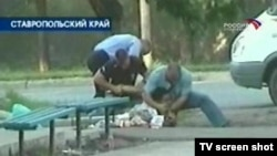 A television screen grab show a victim of the mass clashes.
