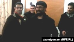 Armenia - Armenian-American businessman Nareg Hartounian is greeted by friends after being released from jail, 13Dec2011.
