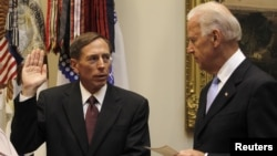 U.S. Vice President Joe Biden (right) swears in David Petraeus as the new CIA director at the White House last year.