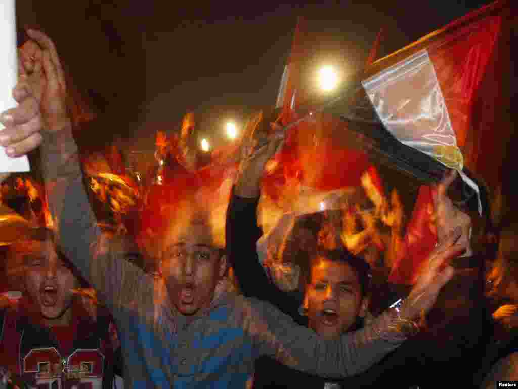 Opposition protesters celebrate Mubarak's resignation on Tahrir Square in Cairo on February 11.