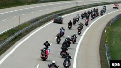 Germany -- Members and sympathizers of the Russian motorcycle club 'Night Wolves' drive on the federal motorway A17 passing the German-Czech border crossing near Breitenau, May 7, 2015