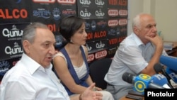 Armenia -- PM Vardan Bostanjian (L) and opposition representative Felix Khachatrian hold a public debate. 13July, 2011