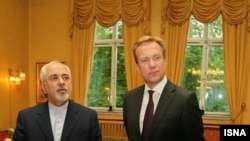 Iranian Foreign Minister Mohammad Javad Zarif meet with Norwegian counterpart Borge Brende on June 12.