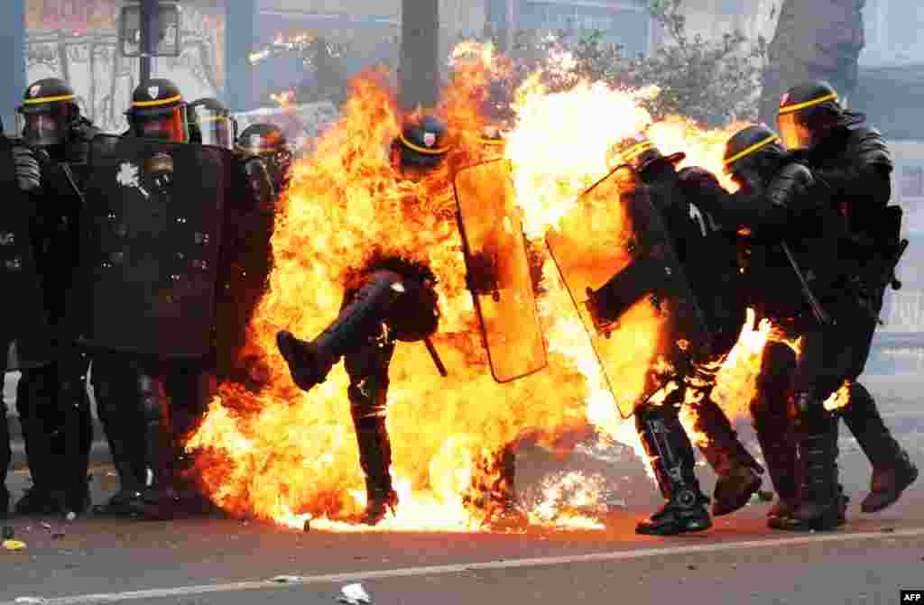 French riot police are engulfed in flames as they face protesters during a May Day workers' rally march in Paris. At least six officers were injured, one with bad burns to his hands and face from Molotov cocktails thrown by protesters. (AFP/Zakaria Abdelkafi)