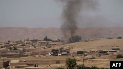 Հելմանդի շրջանը Աֆղանստանի բանակի և թալիբ ապստամբների միջև բախումից հետո, 29-ը հունիսի, 2014թ.