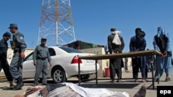 Afghanistan -- Afghan security officials inspect the