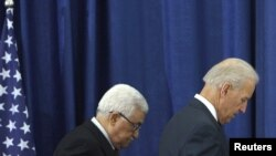 Palestinian President Mahmud Abbas (left) and U.S. Vice President Joe Biden after their joint news conference in the West Bank city of Ramallah