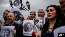 Turkey -- Human rights activists hold placards picturing Armenian intellectuals, detained and deported in 1915, during a rally in Istanbul, April 24, 2016