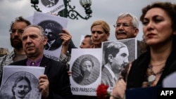 Rights activists hold placards picturing Armenian intellectuals detained and deported in 1915, during a rally in Istanbul in April 2016.